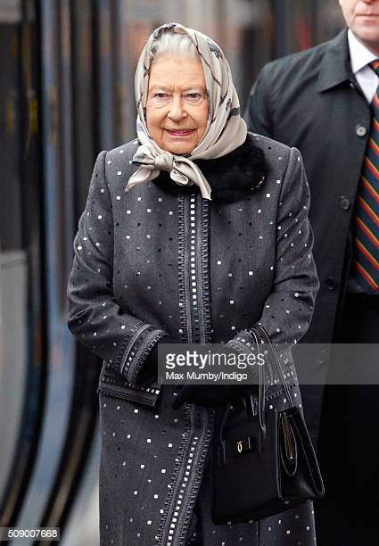 Queen Elizabeth II boards a train at King's Lynn Station to return to London after her Christmas break at Sandringham House on February 8 2016 in...