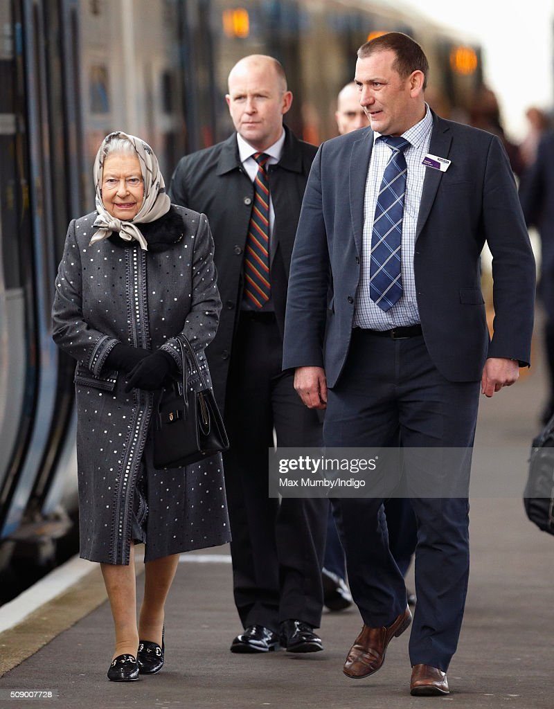Queen Elizabeth II boards a train at King's Lynn Station to return to London after her Christmas break at Sandringham House on February 8, 2016 in King's Lynn, England.