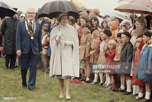 Queen Elizabeth II braves the rain during her visit to New Zealand 1977