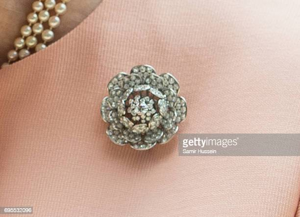Queen Elizabeth II broach detail as she arrives at Paddington station by train to mark the 175th anniversary of the first train journey by a British...