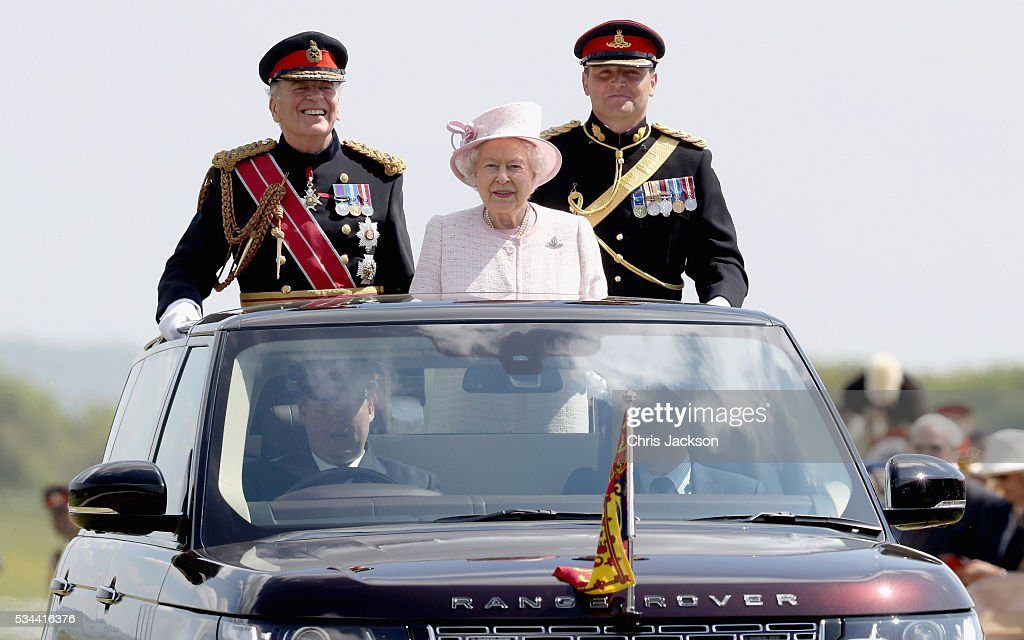Queen <a gi-track='captionPersonalityLinkClicked' href=/galleries/search?phrase=Elizabeth+II&family=editorial&specificpeople=67226 ng-click='$event.stopPropagation()'>Elizabeth II</a>, Captain-General of the Royal Regiment of Artillery, oversees a Royal Review from an open-top Range Rover on the occasion of their Tercentenary at Knighton Down on May 26, 2016 in Lark Hill, England. Queen Eliabeth II has been Captain-General of the Royal Regiment of Artillery since 6 February 1952.