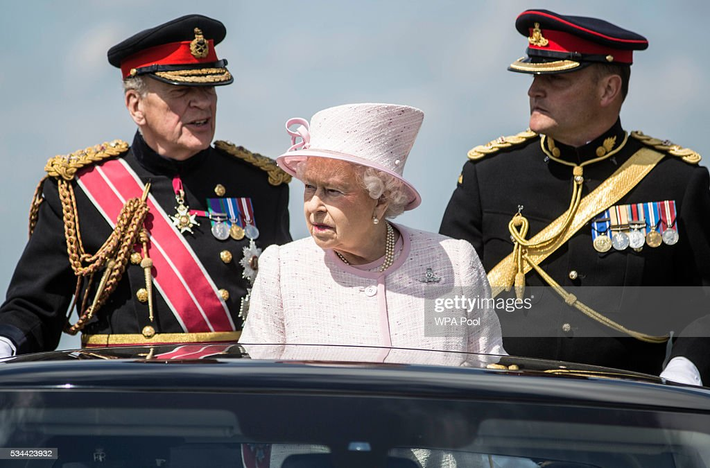 Queen Elizabeth II, Captain-General of the Royal Regiment of Artillery, oversees a Royal Review on the occasion of their Tercentenary at Knighton Down on May 26, 2016 in Lark Hill, England. Queen Eliabeth II has been Captain-General of the Royal Regiment of Artillery since 6 February 1952.