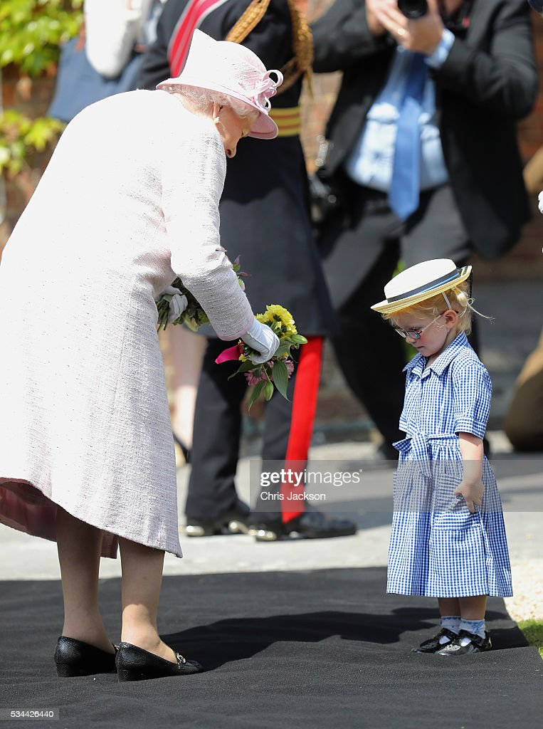Queen <a gi-track='captionPersonalityLinkClicked' href=/galleries/search?phrase=Elizabeth+II&family=editorial&specificpeople=67226 ng-click='$event.stopPropagation()'>Elizabeth II</a>, Captain-General of the Royal Regiment of Artillery, visits the Royal Garrison Church after unveiling a foundation stone for the new chapel and cloister on the occasion of their Tercentenary at Knighton Down on May 26, 2016 in Lark Hill, England. Queen Eliabeth II has been Captain-General of the Royal Regiment of Artillery since 6 February 1952.