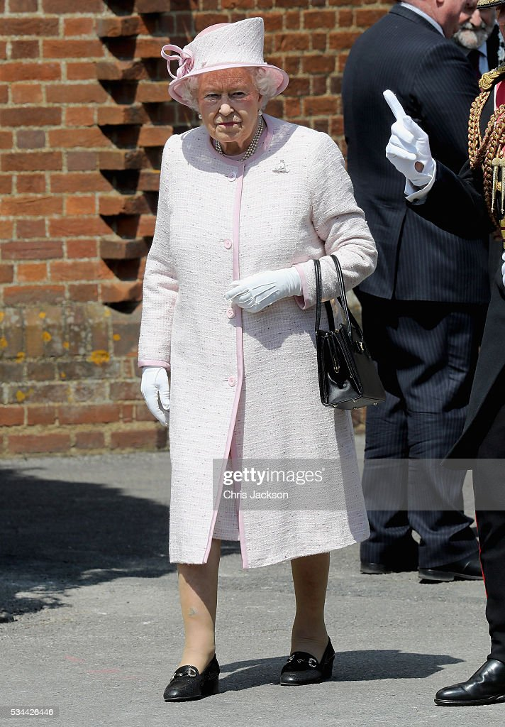 Queen <a gi-track='captionPersonalityLinkClicked' href=/galleries/search?phrase=Elizabeth+II&family=editorial&specificpeople=67226 ng-click='$event.stopPropagation()'>Elizabeth II</a>, Captain-General of the Royal Regiment of Artillery, waves as she leaves the Royal Garrison Church after unveiling a foundation stone for the new chapel and cloister on the occasion of their Tercentenary at Knighton Down on May 26, 2016 in Lark Hill, England. Queen Eliabeth II has been Captain-General of the Royal Regiment of Artillery since 6 February 1952.