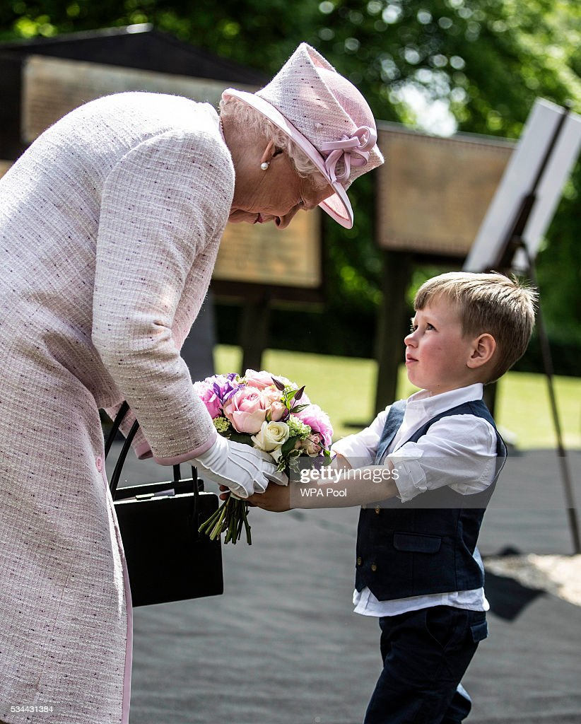 Queen Elizabeth II, Captain-General of the Royal Regiment of Artillery, accepts flowers from Albert Beebe aged four and a half as she oversees a Royal Review on the occasion of their Tercentenary at Knighton Down on May 26, 2016 in Lark Hill, England. Queen Eliabeth II has been Captain-General of the Royal Regiment of Artillery since 6 February 1952.