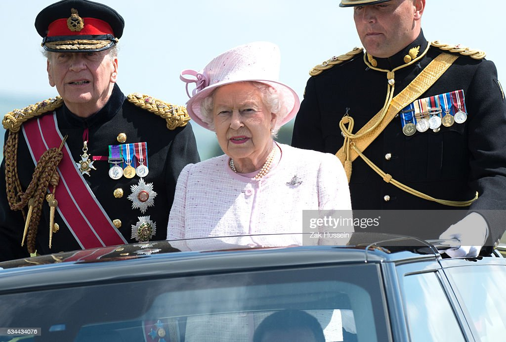 Queen Elizabeth II, Captain-General of the Royal Regiment of Artillery, oversees a Royal Review on the occasion of their Tercentenary at Knighton Down on May 26, 2016 in Lark Hill, England.