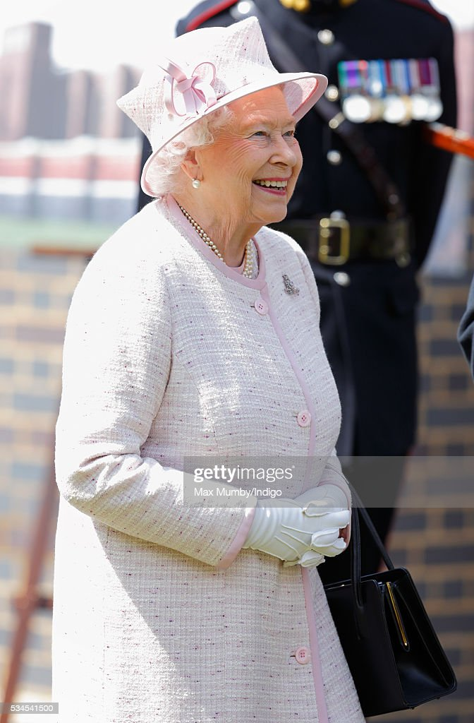 Queen <a gi-track='captionPersonalityLinkClicked' href=/galleries/search?phrase=Elizabeth+II&family=editorial&specificpeople=67226 ng-click='$event.stopPropagation()'>Elizabeth II</a>, Captain-General of The Royal Regiment of Artillery, visits the Royal Garrison Church after attending a review of the Royal Artillery on the occasion of their Tercentenary on May 26, 2016 in Lark Hill, England.