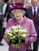 Queen Elizabeth II carries a posy of flowers during a walkabout whilst on a visit to City and Islington College on March 30 2011 in London England