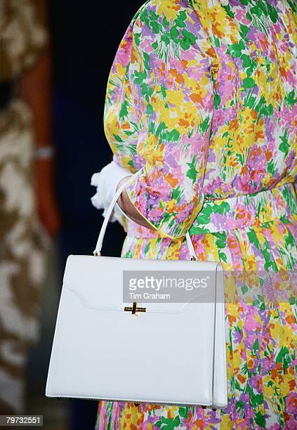 Queen Elizabeth II carries a white handbag with her during an official visit to RAF Akrotiri in Cyprus