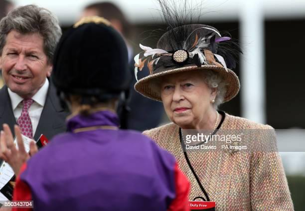 Queen Elizabeth II chats to jockey Hayley Turner before the Dreweatts 1759 Handicap during Dubai Duty Free Spring Trials Raceday at Newbury...