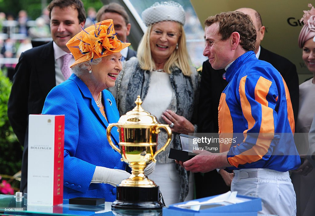 Queen Elizabeth II chats to Jockey Ryan Moore after he guided Order of St George to victory in the Gold Cup in Honour of the Queen's 90th Birthday during Day Three of Royal Ascot 2016 at Ascot Racecourse on June 16, 2016 in Ascot, England.