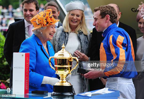 Queen Elizabeth II chats to Jockey Ryan Moore after he guided Order of St George to victory in the Gold Cup in Honour of the Queen's 90th Birthday...