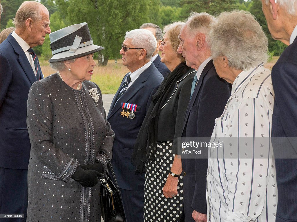 Queen Elizabeth II chats to liberator Capt Eric Brown and Prince Philip, Duke of Edinburgh speaks with survivor Bernard Lavy during their visit of the concentration camp memorial at Bergen-Belsen on June 26, 2015 in Lohheide, Germany. The Queen and The Duke of Edinburgh viewed the grave of Anne Frank and laid a wreath at the inscription wall, before they met two survivors of the camp and as well as two liberators. This is the final day of a four day state visit, which is their first to Germany since 2004.