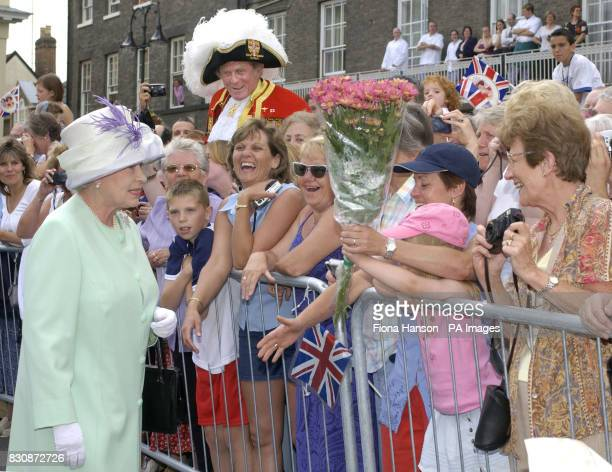 Queen Elizabeth II chats to local well wishers at Angel Hill Bury St Edmunds during her Golden Jubilee visit to Suffolk