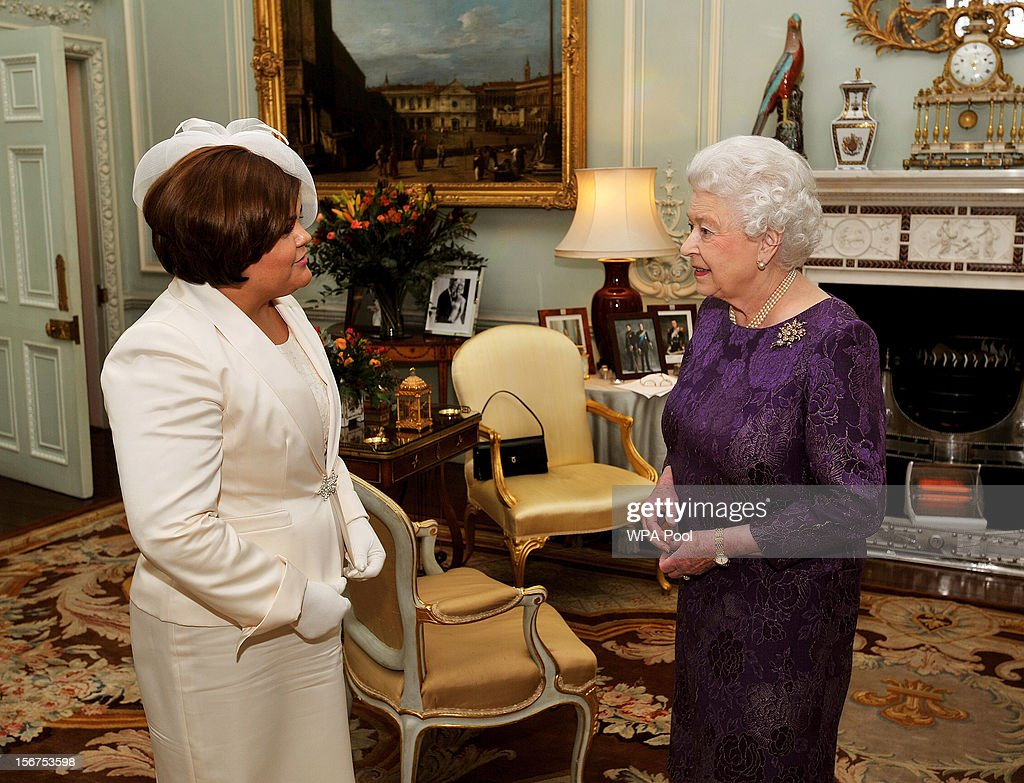 Queen Elizabeth II chats to Ms Perla Perdomo, the new High Commissioner for Belize (L), during a private audience at Buckingham Palace on November 20, 2012 in London, England.