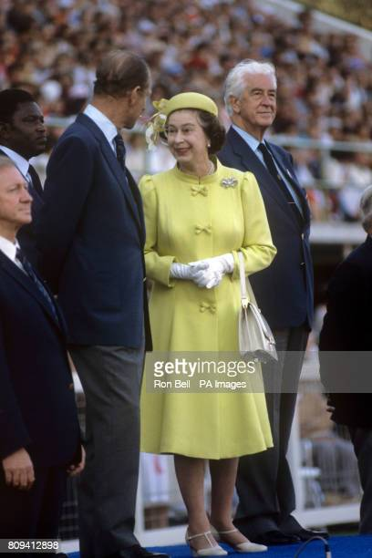 Queen Elizabeth II chats with the Duke of Edinburgh along side Sir Alexander Ross Chairman of the Commonwealth Games Federation at the closing...