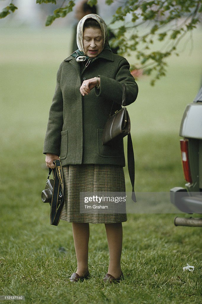 Queen Elizabeth II Checking Her Watch At The Royal Windsor Horse Show Held Home