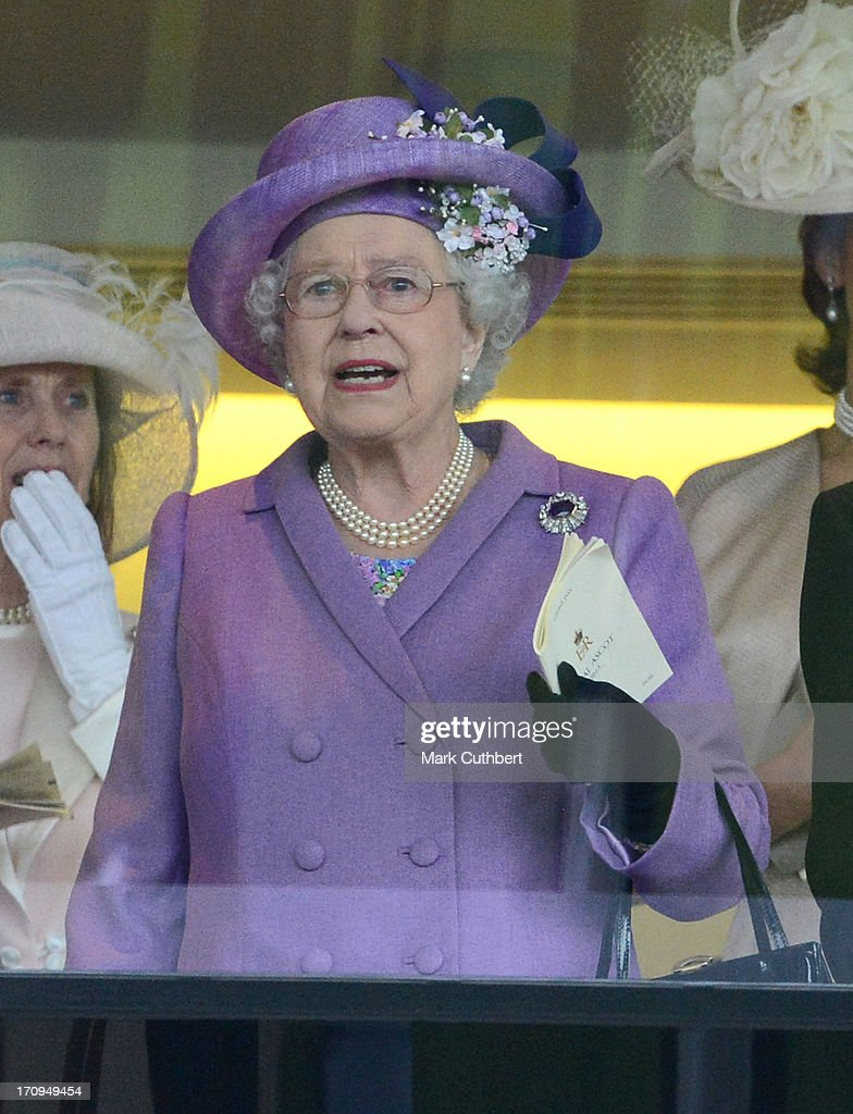 Queen <a gi-track='captionPersonalityLinkClicked' href=/galleries/search?phrase=Elizabeth+II&family=editorial&specificpeople=67226 ng-click='$event.stopPropagation()'>Elizabeth II</a> cheers on her horse 'Estimate' to win The Gold Cup on Ladies Day on Day 3 of Royal Ascot at Ascot Racecourse on June 20, 2013 in Ascot, England.