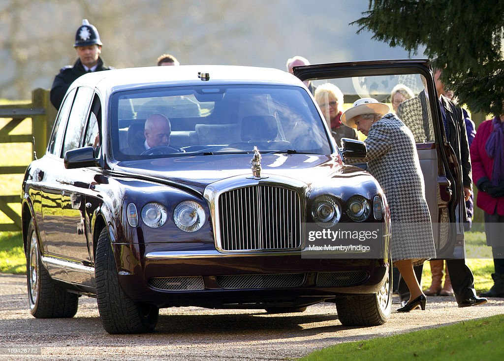 Queen Elizabeth II climbs into her Bentley car, which her chauffeur Joe Last had trouble starting, as she leaves St. Mary Magdalene Church, Sandringham after attending Sunday service along with Prince Philip, Duke of Edinburgh and Lady Helen Taylor on January 13, 2012 near King's Lynn, England.