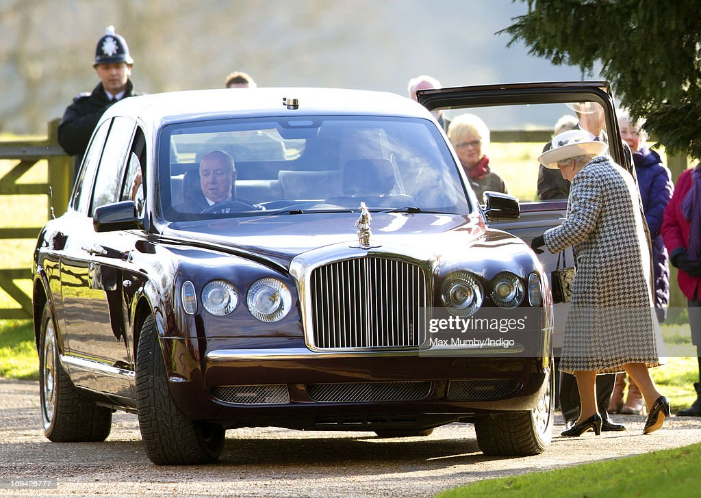Queen <a gi-track='captionPersonalityLinkClicked' href=/galleries/search?phrase=Elizabeth+II&family=editorial&specificpeople=67226 ng-click='$event.stopPropagation()'>Elizabeth II</a> climbs into her Bentley car, which her chauffeur Joe Last had trouble starting, as she leaves St. Mary Magdalene Church, Sandringham after attending Sunday service along with Prince Philip, Duke of Edinburgh and Lady Helen Taylor on January 13, 2012 near King's Lynn, England.