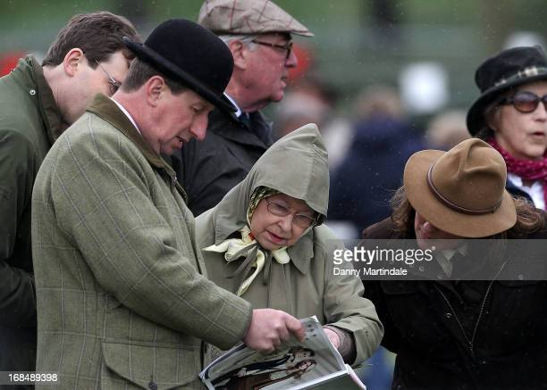 Queen Elizabeth II compares horse's in the program with the show chairman Stuart Cowen on day 3 of the Royal Windsor Horse Show on May 10 2013 in...