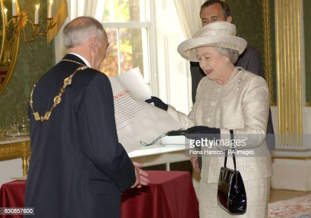 Queen Elizabeth II confers city status on Lisburn Northern Ireland with Letters Patent endorsed by the Great Seal presented to the Mayor of Lisburn...