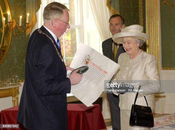 Queen Elizabeth II confers city status on Newry Northern Ireland with Letters Patent endorsed by the Great Seal presented to the ViceChairman of...