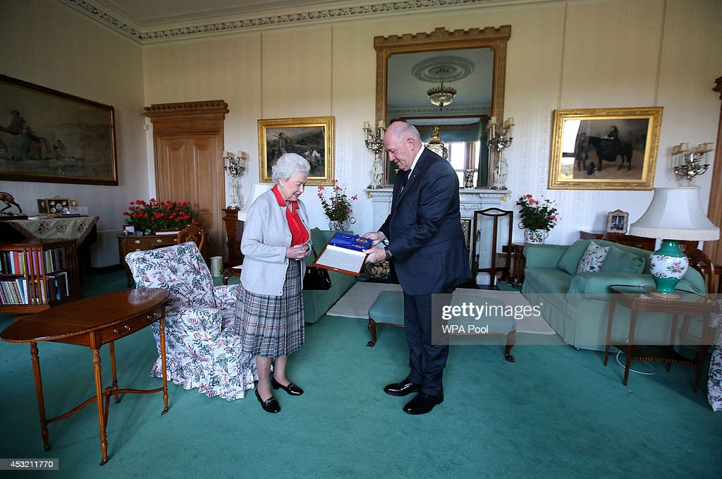 Queen <a gi-track='captionPersonalityLinkClicked' href=/galleries/search?phrase=Elizabeth+II&family=editorial&specificpeople=67226 ng-click='$event.stopPropagation()'>Elizabeth II</a> confers the honour of Knight of the Order of Australia upon His Excellency Sir <a gi-track='captionPersonalityLinkClicked' href=/galleries/search?phrase=Peter+Cosgrove&family=editorial&specificpeople=2499866 ng-click='$event.stopPropagation()'>Peter Cosgrove</a>, the Governor-General of Australia at on August 5, 2014 in Balmoral, Scotland