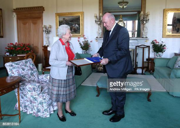 Queen Elizabeth II confers the honour of Knight of the Order of Australia upon His Excellency Sir Peter Cosgrove the GovernorGeneral of Australia at...