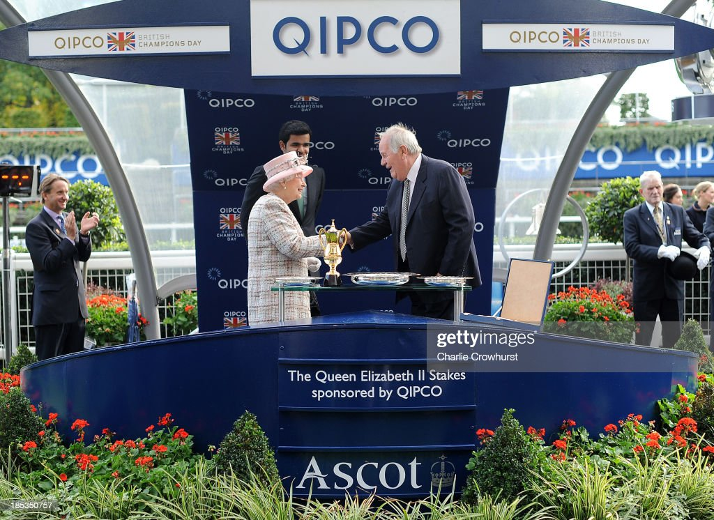 Queen <a gi-track='captionPersonalityLinkClicked' href=/galleries/search?phrase=Elizabeth+II&family=editorial&specificpeople=67226 ng-click='$event.stopPropagation()'>Elizabeth II</a> congratulates winning trainer Richard Hannon after his horse Olympic Glory wins The Queen Elizabeth stakes Sponsored by QIPCO at Ascot racecourse on October 19, 2013 in Ascot, England.