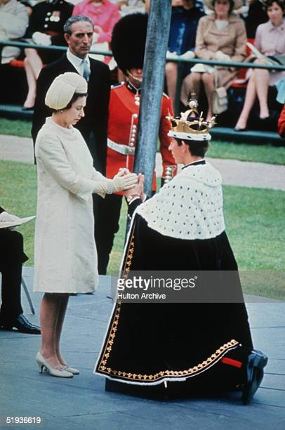 Queen Elizabeth II crowns her son Charles Prince of Wales during his investiture ceremony at Caernarvon Castle 1st July 1969