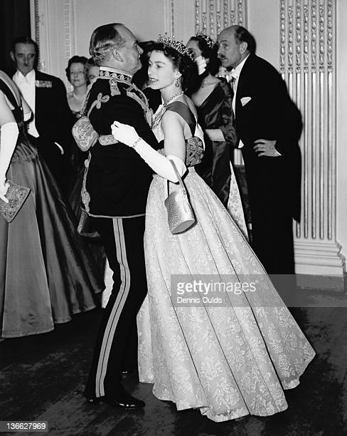 Queen Elizabeth II dancing with Air Marshal Sir John Baldwin colonel of the 8th Hussars at a ball held at the Hyde Park Hotel London 26th November...