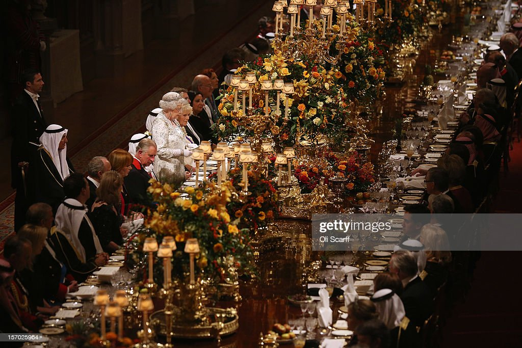 Queen <a gi-track='captionPersonalityLinkClicked' href=/galleries/search?phrase=Elizabeth+II&family=editorial&specificpeople=67226 ng-click='$event.stopPropagation()'>Elizabeth II</a> delivers a speech during a State Banquet for His Highness the Amir Sheikh Sabah Al-Ahmad Al-Jaber Al-Sabah of Kuwait in Windsor Castle on November 27, 2012 in Windsor, England. The Amir of Kuwait is conducting three-day state visit to the UK; tomorrow he will meet with British Prime Minister David Cameron in Downing Street and attend a Banquet at the Guildhall.