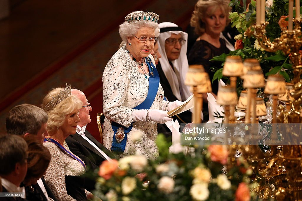 Queen <a gi-track='captionPersonalityLinkClicked' href=/galleries/search?phrase=Elizabeth+II&family=editorial&specificpeople=67226 ng-click='$event.stopPropagation()'>Elizabeth II</a> delivers a speech during a State Banquet in honour of the President of Ireland Michael D. Higgins on April 8, 2014 in Windsor, England. Guests and dignitaries including Irish prime minister, Enda Kenny and Northern Ireland's deputy first minister Martin McGuinness attending the banquet at the end of the first day of a state visit by Ireland's Michael D. Higgins. Ireland's Michael D. Higgins is making the first state visit by a president of the republic since it gained independence from neighbouring Britain. The visit comes three years after Queen <a gi-track='captionPersonalityLinkClicked' href=/galleries/search?phrase=Elizabeth+II&family=editorial&specificpeople=67226 ng-click='$event.stopPropagation()'>Elizabeth II</a> made a groundbreaking trip to the republic, which helped to heal deep-rooted unease and put British-Irish relations on a new footing. Higgins' return visit will be seen as an official sign of further progress following the hard-won peace in Northern Ireland, which remains part of the United Kingdom.