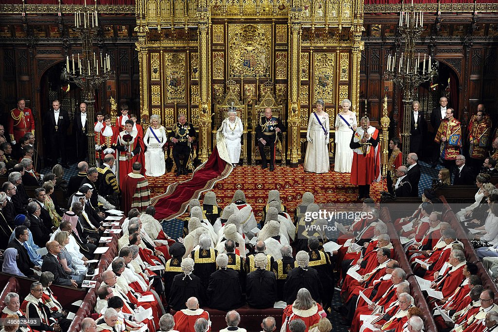 Queen Elizabeth II delivers her speech flanked by Prince Philip Duke of Edinburgh and Prince Charles Prince of Wales and Camilla Duchess of Cornwall...