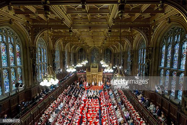 Queen Elizabeth II delivers the Queen's Speech from the throne as Prince Philip Duke of Edinburgh Prince Charles Prince of Wales and Camilla Duchess...