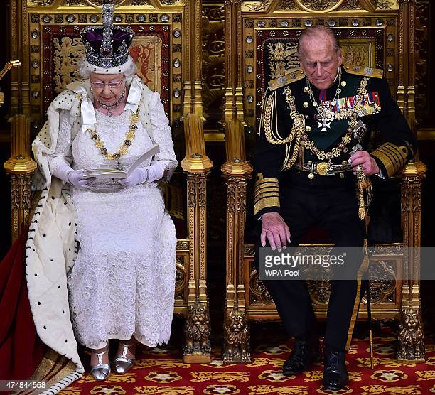 Queen Elizabeth II delivers the Queen's Speech from the throne in the House of Lords next to Prince Philip Duke of Edinburgh during the State Opening...