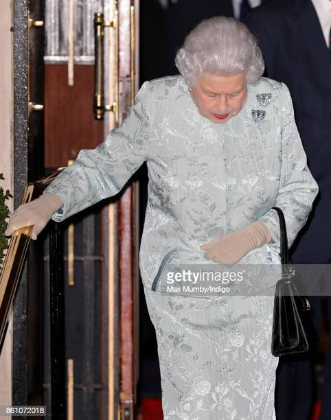 Queen Elizabeth II departs after attending a reception to mark the Centenary of the Women's Royal Navy Service and the Women's Auxiliary Army Corp at...