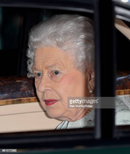 Queen Elizabeth II departs in her Bentley car after attending a reception to mark the Centenary of the Women's Royal Navy Service and the Women's...