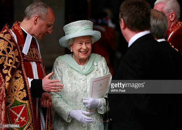 Queen Elizabeth II departs St Paul's Cathedral after a service of thanksgiving with the Dean of St Paul's David Ison on June 5 2012 in London England...