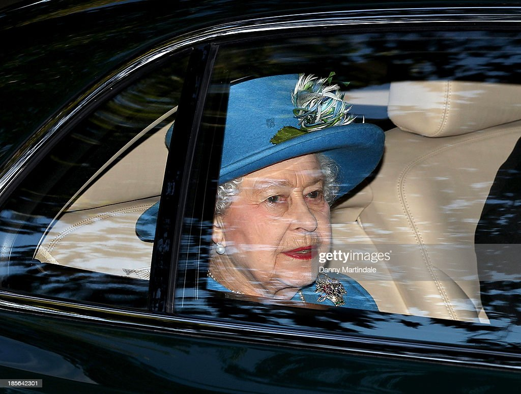 Queen <a gi-track='captionPersonalityLinkClicked' href=/galleries/search?phrase=Elizabeth+II&family=editorial&specificpeople=67226 ng-click='$event.stopPropagation()'>Elizabeth II</a> departs the christening of the three month-old Prince George of Cambridge by the Archbishop of Canterbury at St James' Palace on October 23, 2013 in London, England.