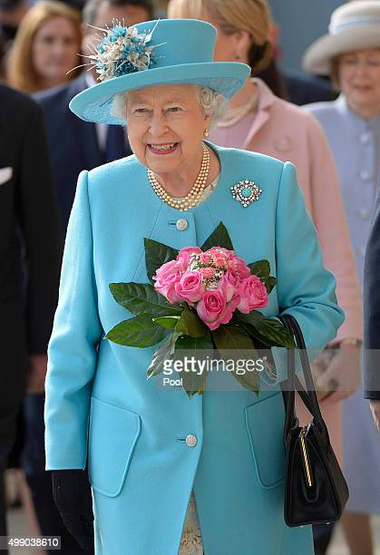 Queen Elizabeth II disembarks after a tour of the Grand Harbour in a traditional Maltese fishing boat with the HMS Bulwark amphibious assault ship...