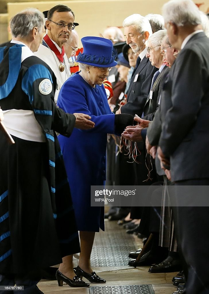 Queen Elizabeth II distributes Maundy money during the Maundy service, at Christ Church Cathedral on March 28, 2013 in Oxford, England. The Maundy money was today distributed by the Queen to 87 women and 87 men, who each received two purses, one red and one white. A 5 GBP coin and 50 pence coin commemorating the 60th anniversary of The Queen's Coronation in the red purse. The white purse contains the uniquely minted Maundy Money. This takes the form of silver one, two, three and four penny pieces, the sum of which equals the number of years the Monarch's age.