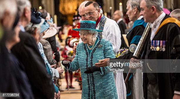 Queen Elizabeth II distributes the traditional Maundy money to 180 people 90 men and 90 women symbolising her age during the traditional Royal Maundy...