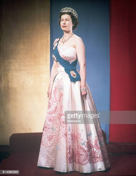 Queen Elizabeth II dressed for a formal occasion She wears her family's orders and orders of her kingdom on the sash over her shoulder and several...