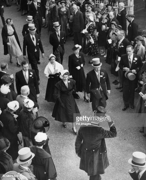 Queen Elizabeth II dressed in black with a white hat followed by Princess Margaret and the Princess Royal near the Paddock at Ascot Racecourse on the...