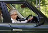 Queen Elizabeth II drives her Range Rover car as she watches the International Carriage Driving Grand Prix event on day 4 of the Royal Windsor Horse...