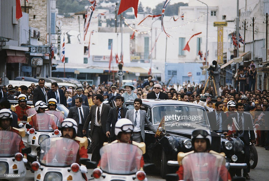 Queen Elizabeth II drives through Tunis with Tunisian President <a gi-track='captionPersonalityLinkClicked' href=/galleries/search?phrase=Habib+Bourguiba&family=editorial&specificpeople=213571 ng-click='$event.stopPropagation()'>Habib Bourguiba</a> (1903 - 2000) during a State Visit to Tunisia, October 1980.