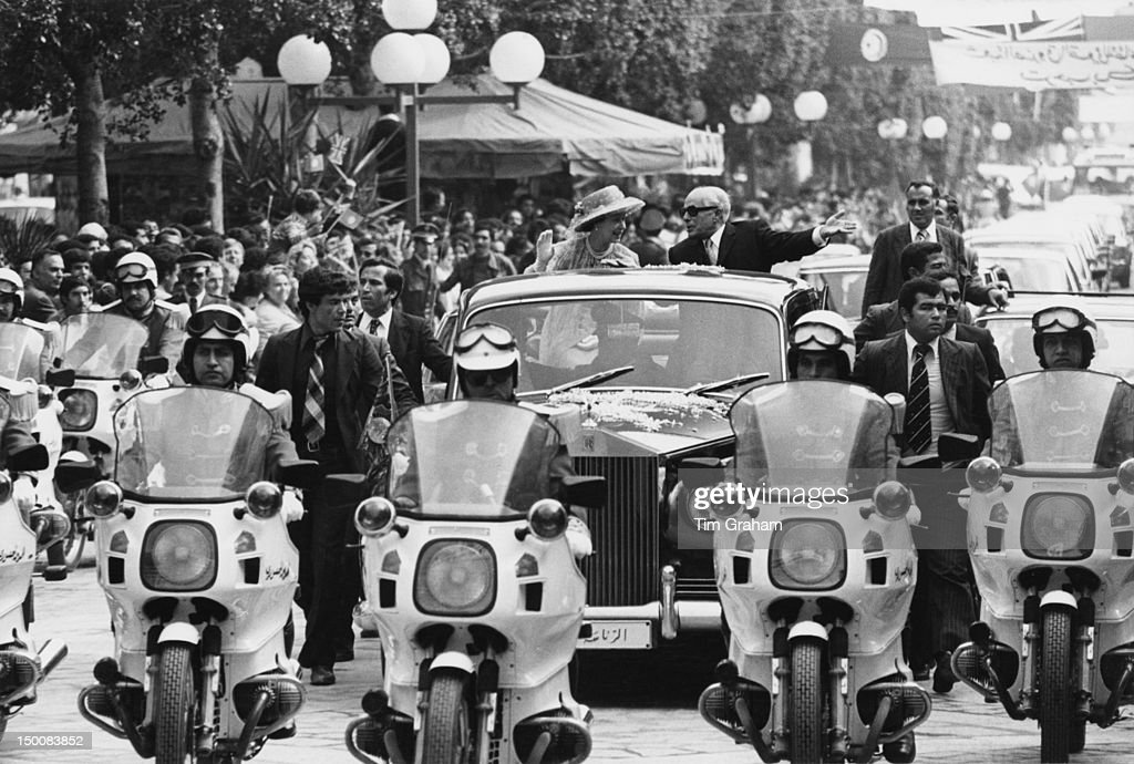 Queen Elizabeth II drives through Tunis with Tunisian President <a gi-track='captionPersonalityLinkClicked' href=/galleries/search?phrase=Habib+Bourguiba&family=editorial&specificpeople=213571 ng-click='$event.stopPropagation()'>Habib Bourguiba</a> (1903 - 2000) during a State Visit to Tunisia, 21st October 1980.
