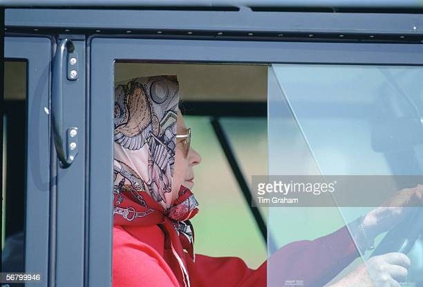 Queen Elizabeth II driving her own Land Rover in the grounds of Windsor Castle